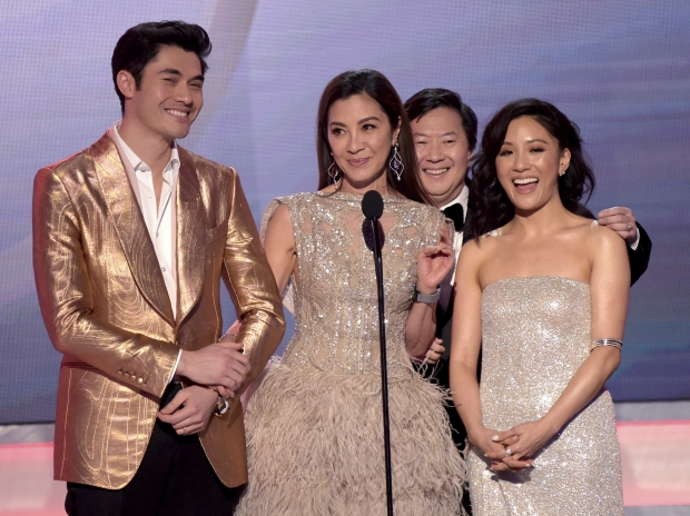 Image showing four actors from Crazy Rich Asians accepting an award